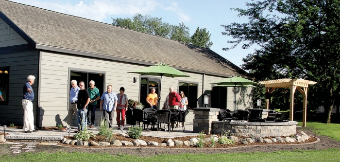 Benson Golf Club Board Chair Jerry Peterson, at left, gives the Benson City Council a tour Monday night of the improvements recently made to the exterior of the clubhouse and the grounds.