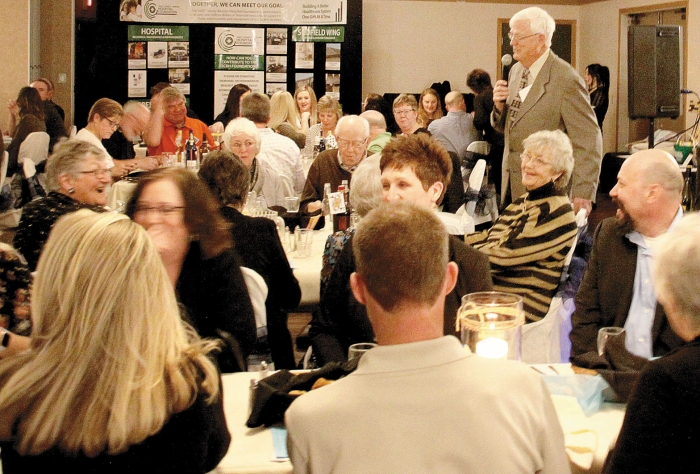 Swift County-Benson Health Services Foundation President Jerry Peterson informs, and entertains, the crowd gathered for the annual Emerald Eve fundraising event at McKinney's on Southside Friday evening.