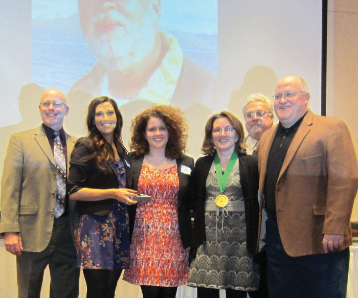 Becca Kufrin, along with sister Emily and mother Jill, are pictured at a February 2012 ceremony where the late Steve Kufrin was inducted into the Minnesota Waterfowl Hall of Fame. At right, is BHS graduate and former local State Farm agent Paul Hanson.