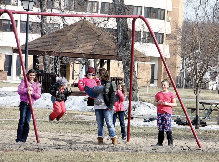 With the temperarure reaching the year's high of 57 degrees last Wednesday children who have been cooped up all winter long were anxious to be outside playing.