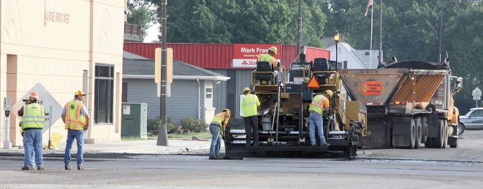A new layer of bituminous is laid down on Minnesota Highway 29 north of the 14th Street stoplights.