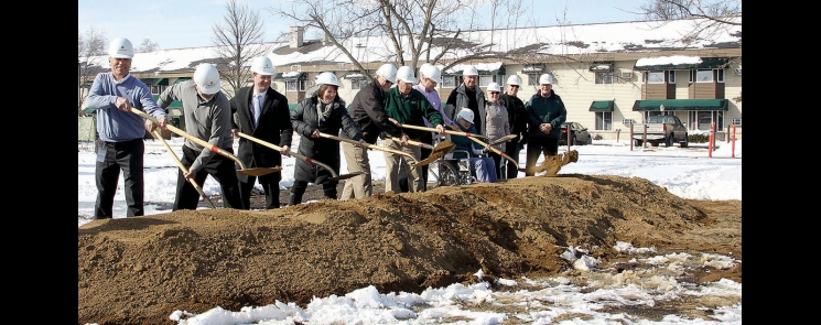 Dan Enderson, Kory Johnson, Ben Wilcox, Terri Collins, Jerry Peterson, Ron Laycock, Kurt Waldbillig, Donna Force, Tom Anderson, Marlys Boone, Mark Frank, and Bob Hoberg help break ground for Scandi Haven Village last Wednesday. They represented hospital staff, board of governors, the City of Benson, Scofield Place, and the Sonsteng Foundation.