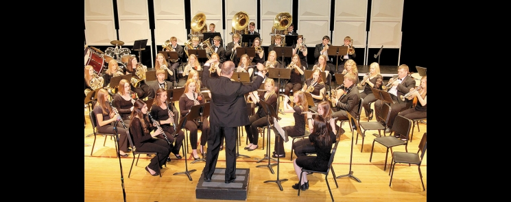 Brock Duncan directs the Concert Band during its portion of the senior high (grades 9-12) Spring Concert.