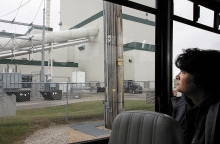 Benson Mayor Terri Collins looks at the former Benson Power biomass electric generation plant during a city council tour of the community Monday night.