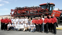 Benson High School students and faculty pose with the staff of Case IH for a photo following the presentation of a $25,000 check. The funds will go to the machining and welding  programs.