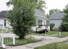 As he fled Benson police, Bernie Drivdahl smashed into Juan Reyes' pickup on 12th Street South, shoving it up against Deb Beyer's house. Drivdahl's pickup continued through a hedge, across an alley, and into a vacant house to the north. He is currently hospitalized in St. Cloud with multiple fractures and other injuries.