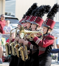 Members of the Benson High School Marching Band Allie Mitteness, Logan Johnson, Bella Wolter, Brenna Knutson, and Katelyn Tolifson perform in last Thursday's Pioneerland Band Festival parade.